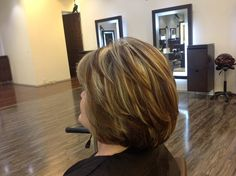 Cascading layers on a short haircut with pattern matching blonde highlights that uses the client's natural color as the dark shade. @Dres Hair Salon Scottsdale, AZ
