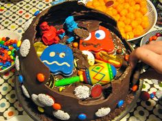 Pinata Cake - Thin chocolate dome over a cake topped with candy & toys