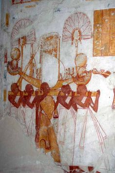 Priests carry Montu's barque; pillar of the temple of Montu (Medamud), Egypt. Montu was a falcon-headed, god of war. He was the patron god of Thebes