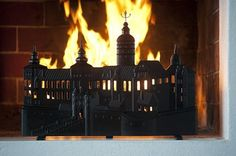 Fireplace screen of castle on fire, made by the Lyrestads gjuteri foundry