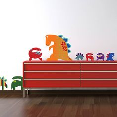 A cute friendly patterned dinosaur wall sticker set! It comes with 12 dinosaurs each with their own pattern and design ranging from to a massive tall. T-rex, Stegosaurus, Plesiosaur and Diplodocus (or maybe Brontosaurus! These wall Dinosaur Gifts, Cute Dinosaur, Dinosaur Wall Decals, Largest Dinosaur, Quirky Decor, Red Candy, Vinyl Designs, T Rex, Kids Room
