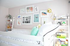 girl room gallery wall over bed The wall color is Benjamin Moore Wild Aster
