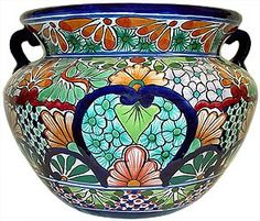 I love the colors in Talavera pottery.  Online at this site they range from $80 to $130, but I like to shop for mine at Merchado Mexico in Houston, and at the Merchado in San Antonio