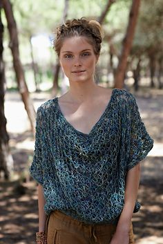 Ravelry: Lake pattern by Marie Wallin  Knit this womens oversized openwork tee from the Silkystones Collection. With an effective openwork lace stitch pattern throughout, ribbed welt and garter stitch borders, this knitting pattern is suitable for the beginner knitter.