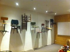 Interior shop design for Jamie's Secrets & Vintage Treets. Put a series chairs up to the wall to use as shelving.