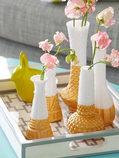 Start at the thrift store, end at the Christmas tree. Milk glass vases are an inexpensive purchase; adhere a line of painters tape to the midsection and brush on gold acrylic paint to the line. Let dry and repeat for full coverage. Replace the tape with a bow -- and gifting is done.