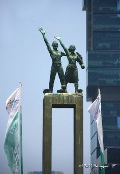 The Welcome Statue characters- these are Constructionist style statues depicting Indonesian Youth welcoming anyone from any nation- which were built when Jakarta was basically a large town with few buildings taller than a Mosque tower or cathedral spire.  Photo is from HarryPWT  at   http://www.flickr.com/photos/harrypwt/