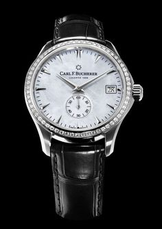 The #carlfbucherer Manero Peripheral Mother-of-Pearl watch is powered by the brand's in-house automatic caliber CFB A2050.  It features a 40.6 mm case with an outer bezel embedded with 60 diamonds and is shown here with a soft white mother-of-pearl dial and black leather alligator strap.  More @ http://www.watchtime.com/wristwatch-industry-news/watches/carl-f-bucherer-manero-peripheral-mother-of-pearl-luxury-for-ladies/ #watchtime #ladieswatches #watchgeek #Baselworld2017