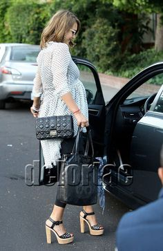 Actress Jessica Alba seen out and about doing some last minute baby shopping toting a black quilted 'Cannage' Miss Dior lambskin and silver tone jewellery.    *courtesy of Delortae Agency UK's exclusive luxury authentic handbag SPA Visit us on Facebook: www.facebook.com/DelortaeAgency