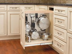 Great idea for narrow lower cupboard beside stove.  DIY as this is too expensive from Rev a Shelf