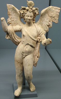 standing Eros with nebris - terracotta statuette from ancient Myrina, circa 100-50 BC, from Hellenistic period