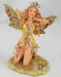 The Ruby Faerie by Christine Haworth from Absolute Angels is a gorgeously coloured and detailed piece She is clothed in a yellow dress dripping with ruby crystals Ruby