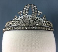 In 1927 this bride wore a metal and rhinestone tiara with her silk gown on her wedding day.