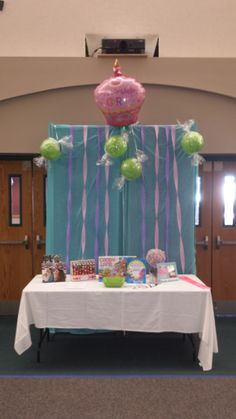 Guestbook and favor table at the Candy Land First Birthday Party