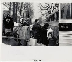 Students with suitcases boarding a bus at the College Street bus stop :: Archives & Special Collections Digital Images :: circa 1966-1967