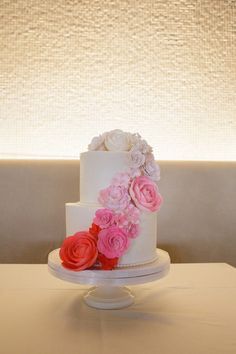 This two-tiered cake with pink ombre rosettes is almost too pretty to eat! {Jeannemarie Photo}