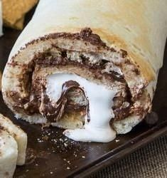 S'mores Pizza Roll-Ups Make a breakfast full of delightness with just minimum efforts and basic ingredients you already have on hand. With refrigerated pizza crust, quick-cooking oats, Graham crackers, marshmallows and chocolate chips you will be able to make the tastiest breakfast treat full of chocolatey flavour that will wake you up and fill with energy. It will […] Continue reading... The post S'mores Pizza Roll-Ups appeared first on All The Food That's Fit To Eat . ..
