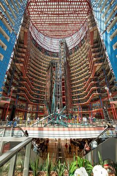 The Thompson Center in Chicago is an example of mixed use building as it has both government offices and stores, and it's also a public space as people can enter. It also has a CTA station within it making it more accessible to the public. James Thompson, Thompson Center, Mall Design, Chicago Art, Atrium, Shopping Mall, Louvre, Public, Country