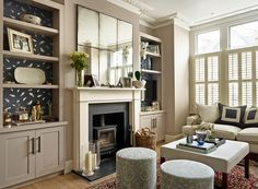 Love the built ins with a pop of color. Lily Paulson-Ellis Designs Living Room with antique mirror, joinery with feature back wallpaper and upholstered stools Home Living Room, Home, Living Room Shelves, Wallpaper Living Room, Living Room Diy, Interior Design, Home And Living, Cosy Living Room, Victorian Living Room