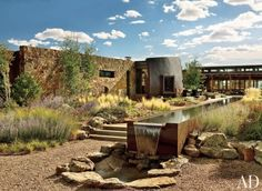 Architect Tim Blonkvist integrated the environmentally sensitive house he built for a Santa Fe couple right into the hillside site. Murase Associates designed the granite hardscape, including sculptural water features, and Design Workshop installed drough Landscape Architecture, Landscape Design, Architecture Design, Desert Landscape, Garden Design, Jacuzzi, Santa Fe Home, Nachhaltiges Design, Rustic Exterior