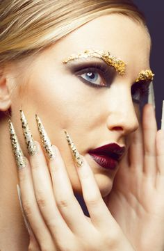 Goldleaf eyebrows  plum lips Black smokey eye