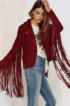 The Lady Stardust Jacket is made in a soft red suede and features an asymmetric zip closure and killer fringe on the back and sleeves!