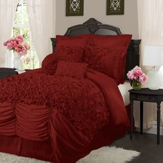 Ruffled comforter set with hand-sewn detailing in red.   Product: 1 Comforter, 1 bed skirt and 2 pillow shamsConstruc...