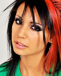 I love the eyes and I used to have my hair dyed like this (bright/dark red not orange).  I think that I want to dye rather than the the whole strand.  If its dyed like mine was you can choose how much red shows up depending on the mood.  Like Pixy in LA Ink