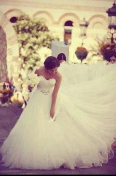 The amount of tulle in this dress is unbelievably pretty. If I got married tomorrow, this would be the one! Beautiful design.