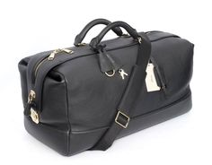 This #black #leather duffel #bag is a completely charming weekend #travel piece!  |  Find yours! http://www.frieschskys.com/bags  |  #frieschskys #mensfashion #fashion #mensstyle #style #moda #menswear #dapper #stylish #MadeInItaly #Italy #couture #highfashion #designer #shopping