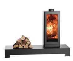 Nestor Martin TQH13 wood burning stove, shown on long base with swivel rotator.