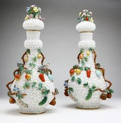 A pair of Meissen style 'Schneeballen' porcelain covered bottle vases, With underglaze blue crossed swords mark to underside, one further inscribed ''1867'', each with domed stopper top with floral bouquet and birds, over a gourd-form body applied with fines and fruiting branches, encrusted overall with white flowers.