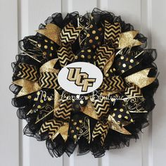 A personal favorite from my Etsy shop https://www.etsy.com/listing/272837336/university-of-central-florida-wreath-ucf