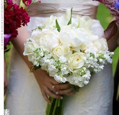 white and ivory bouquet was a lush arrangement of roses, lilies, and peonies