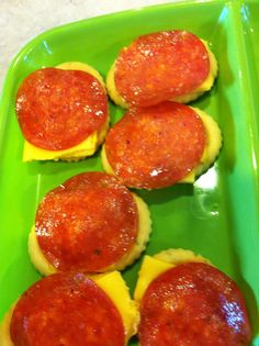 Fun, cheap & easy snack for my picky eaters! Garlic & herb crackers, cheese & top with pepperoni. Microwave for 10 secs!