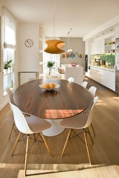 Oval. Eero Saarinen's iconic modern oval dining table This stunning design is made in either a 78-in. (198-cm) length and 47¾-in. (121-cm) width, or a 96-in. (244-cm) length and 54-in. (137-cm) width. In this space the table is paired with Eames molded fiberglass dowel-leg side chairs, which have a footprint of 18½ in. in width and 21 in. in depth each (47 by 53 cm). Oval shapes can sometimes help smaller spaces flow since no one will need to navigate a square corner.