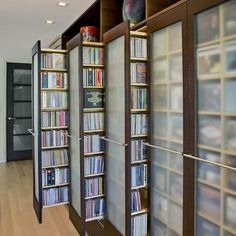 """by John Senhauser Architects media pull out cupboards """"space with accessibility rather than stacking books and videos covering each other"""""""