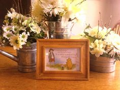 Flowers in galvanized cans, and Classic Pooh quote, decorations for baby shower.