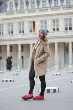 Girl outfit fashion blogger camel coat red shoes sneakers nike