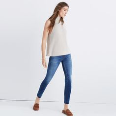 A swingy mockneck sweater with cool cutaway armholes. Sleek and substantial, it's one to layer now and wear as a tank later. <ul><li>True to size.</li><li>Cotton.</li><li>Hand wash.</li><li>Import.</li></ul>