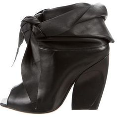 Christian Dior Brooklyn Peep-Toe Booties https://api.shopstyle.com/action/apiVisitRetailer?id=618026201&pid=uid8721-33958689-52