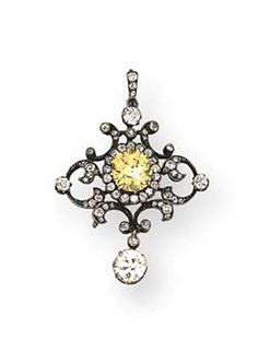 An Antique Diamond And Fancy Intense Yellow Diamond Pendant Brooch   The central oval-cut diamond weighing 3.38 carats within old mine-cut diamond surround to the scrolled shaped trefoil and hook, suspending an articulated diamond collet pendant, mounted in silver and gold, circa 1890, 5.0 cm. long