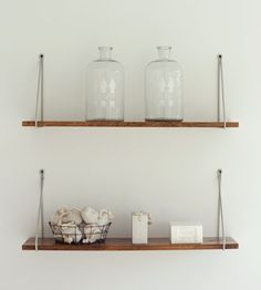 """open shelving similar to this would create an """"open space"""" while still providing you with space for storage (and putting baskets). Or you can put the brackets underneath the board (& you can use pallet wood. cheap)"""