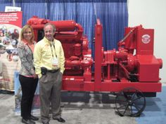 Editor of Pumps & Systems magazine Michelle Segrest and Terry Aylward of Griffin Pump with a 'iron-wheeled' antique Griffin Wellpoint Dewatering Pump.