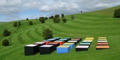 Leon van den Eijkel    Red Cloud Confrontation in Landscape  1996  25 cast formed and painted   concrete cubes 17.5 x 17.5m