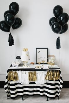 Black and gold - love the pom pom decoration