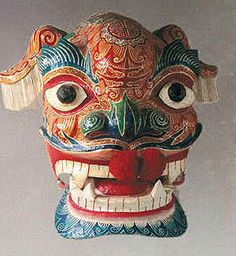 Chinese Mask - Lion mask from China. painted papier mache with movable jaw and ears, puff balls