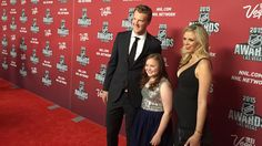 Dubnyk and his wife pose with Jordyn Leopold on the Red Carpet at #NHLAwards. #votenhltrademydad
