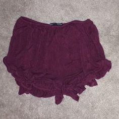 Flowy Shorts these are the classic Brandy Melville flowy shorts in maroon. I've never worn them before and it was too late for me to exchange them. Brandy Melville Shorts