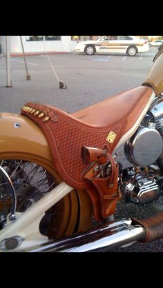 Leather holster and seat on a motorcycle. Beautifully executed.